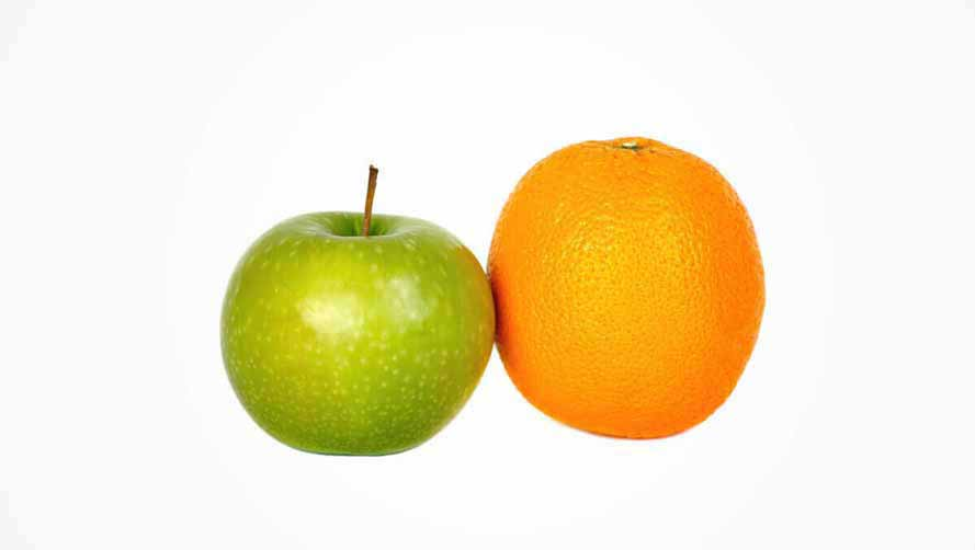A green apple and an orange with white background