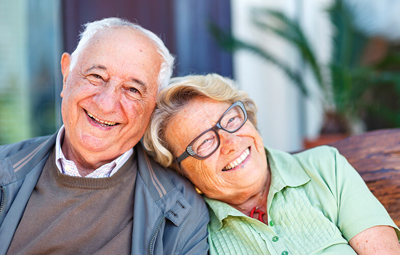 Elderly-couple-laughing and leaning on each other