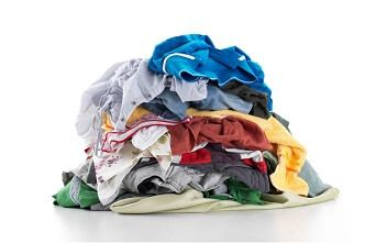 Pile of various coloured clothes on white background