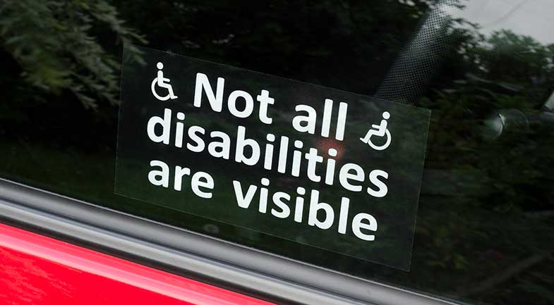 "A car sticker with written, ""Not all disabilities are visible"""