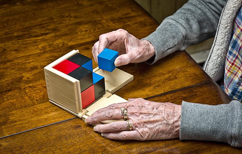 Senior-Woman-Dementia-Patient-Works-on-a-Puzzle