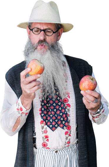 Man with beard holding 2 apples