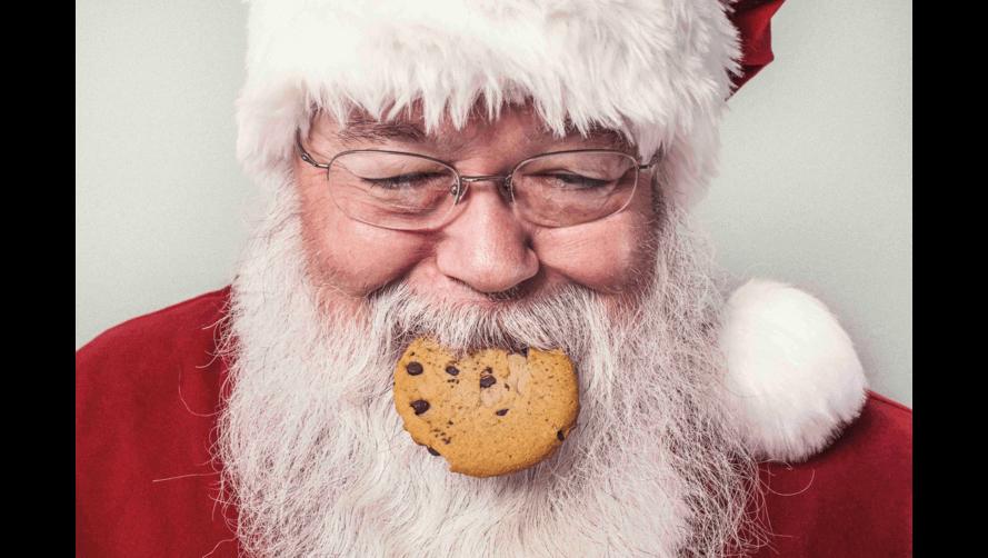 Santa eating a choc chip cookie