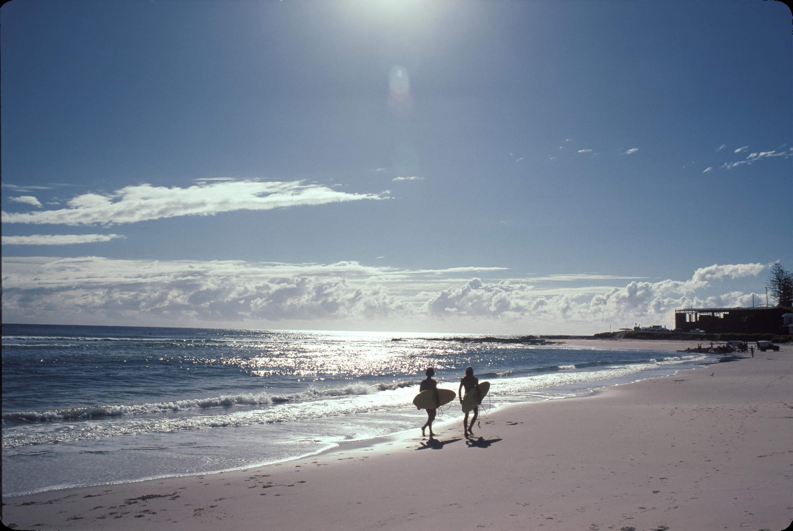 Queensland beach with glistening ocean and blue skies
