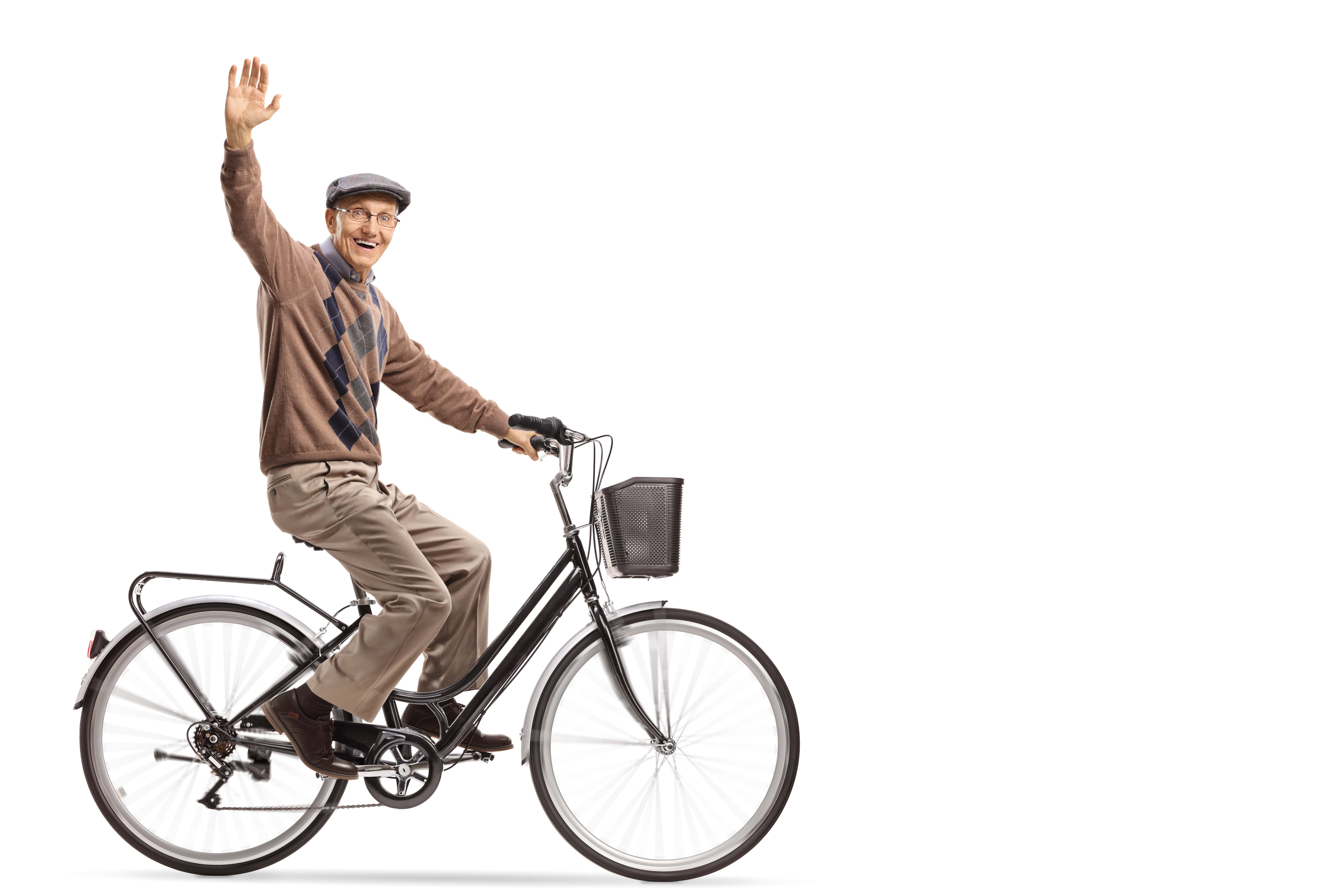 Older man riding a vintage bicycle and waving