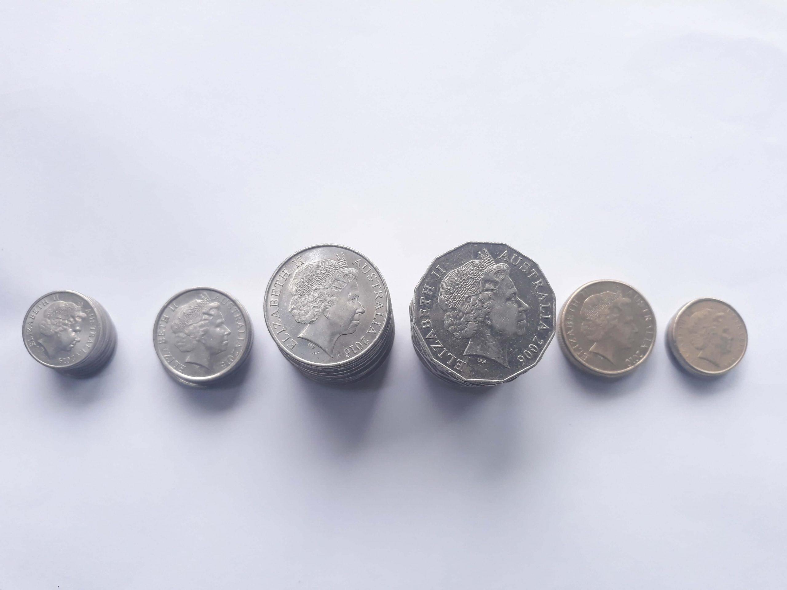 Horizontal row of Australian coins on a grey tabletop