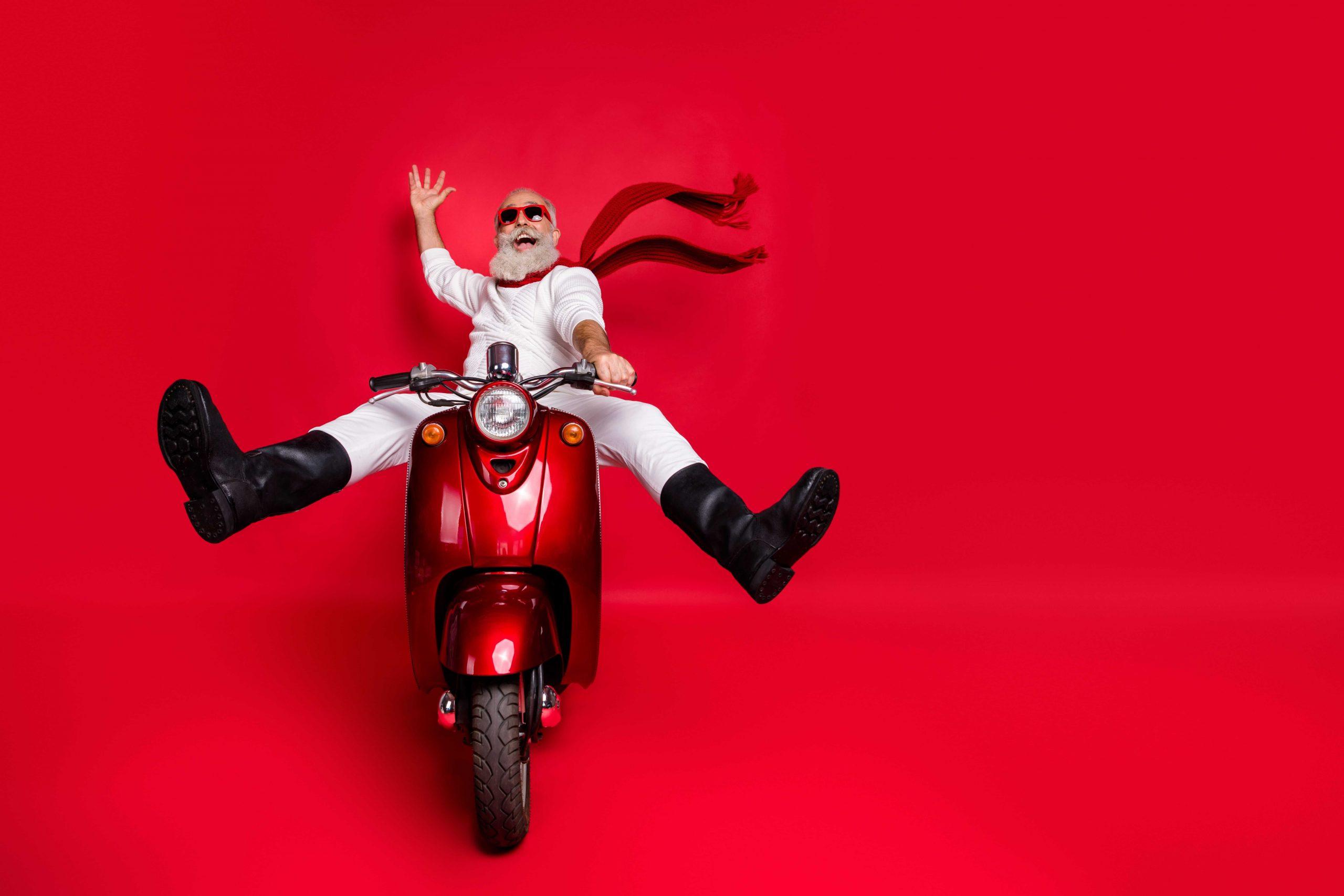 Senior man riding happily on a motorbike