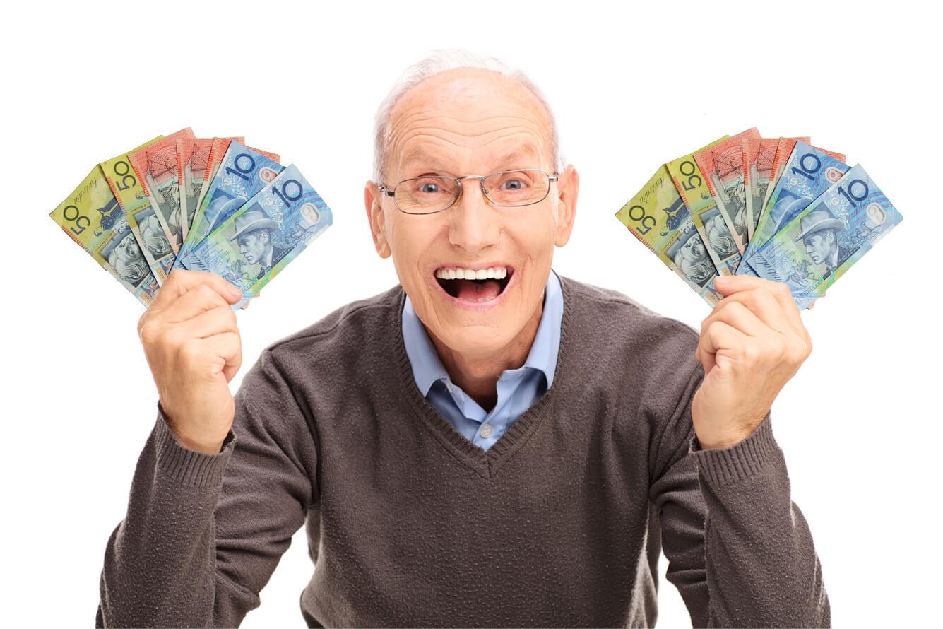 Senior gentleman with fans of money in his hands