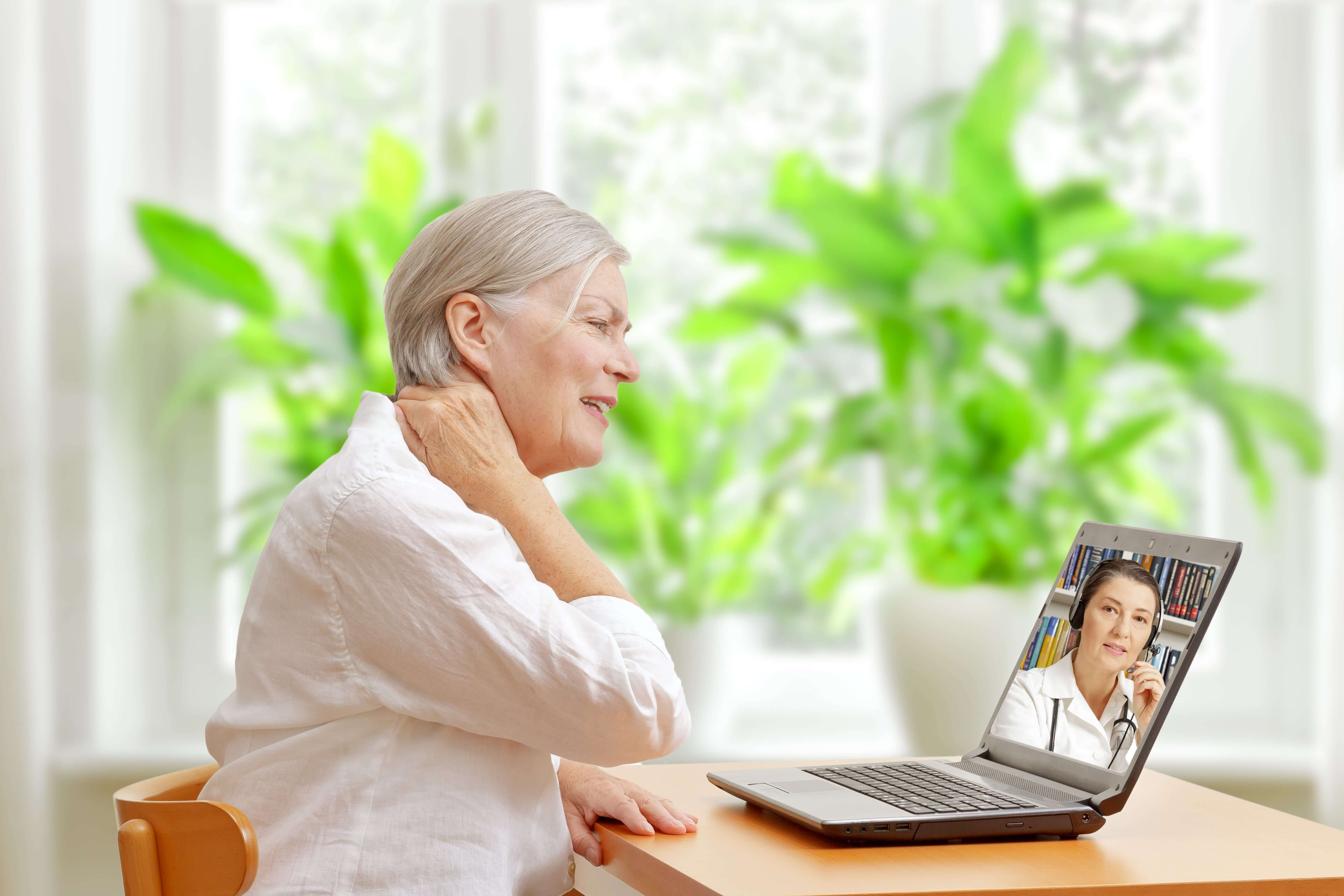 Senior woman attending a telehealth appointment from her home