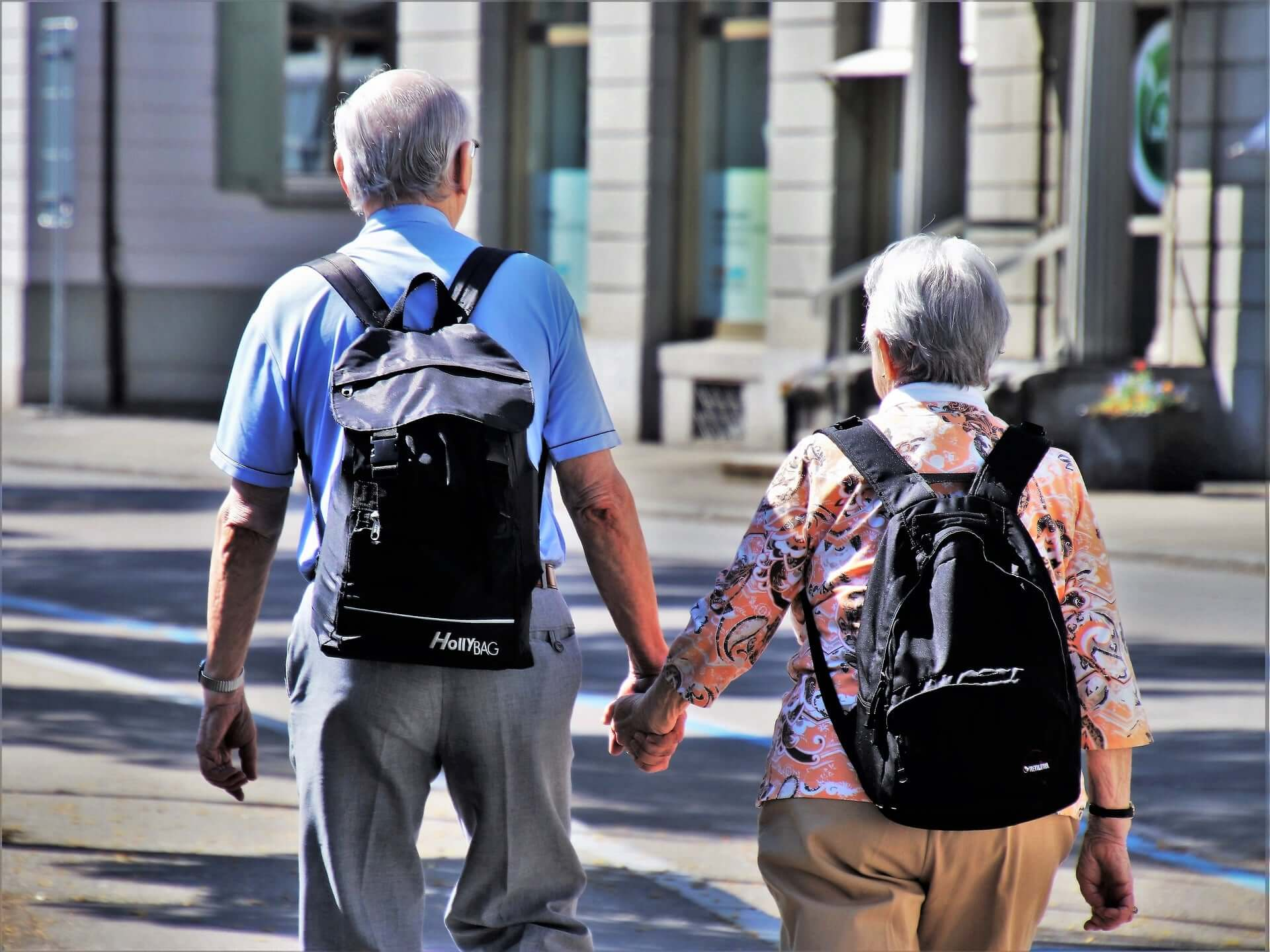 Senior tourist couple holding hands