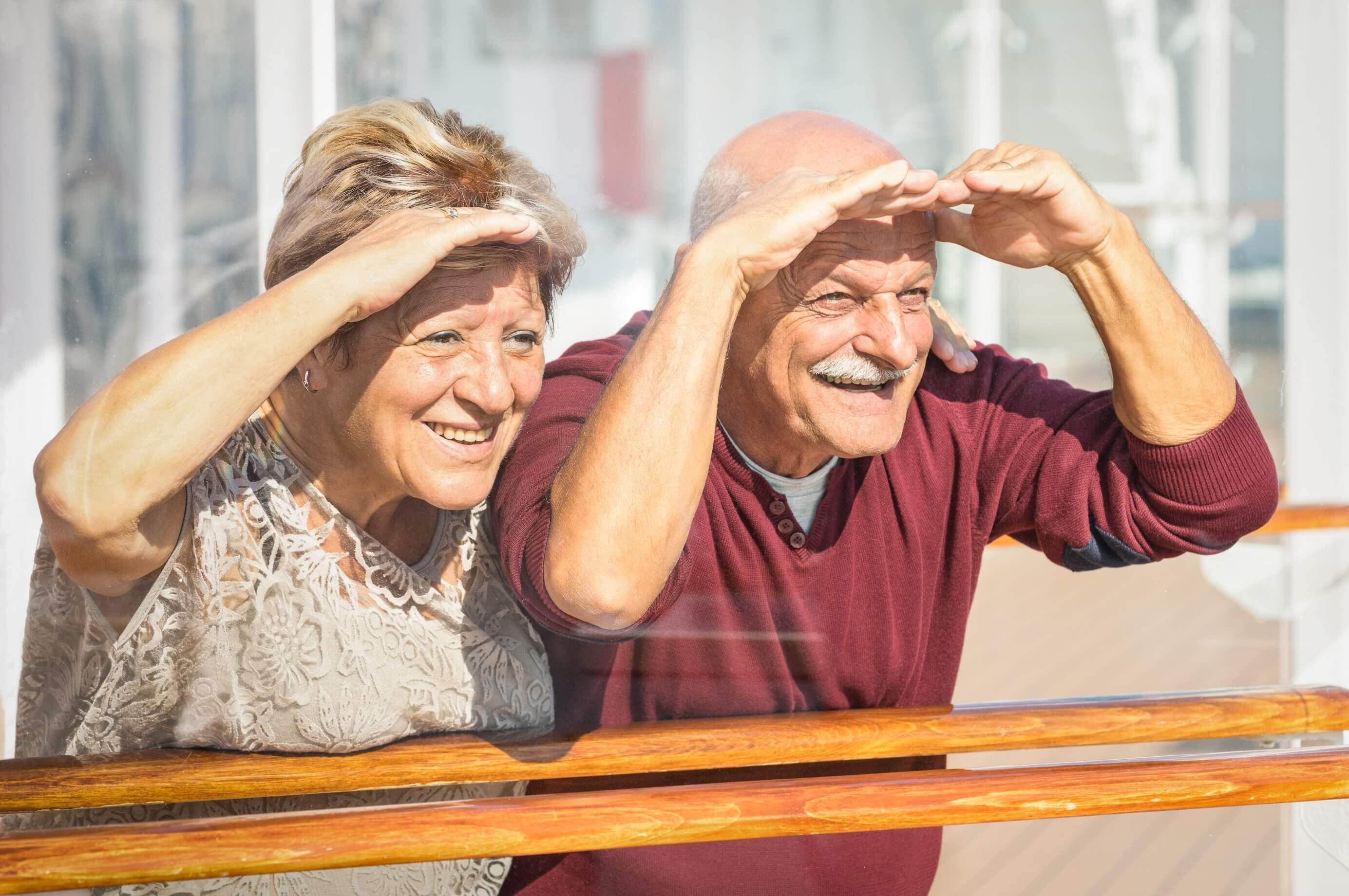 Senior couple peering into the future