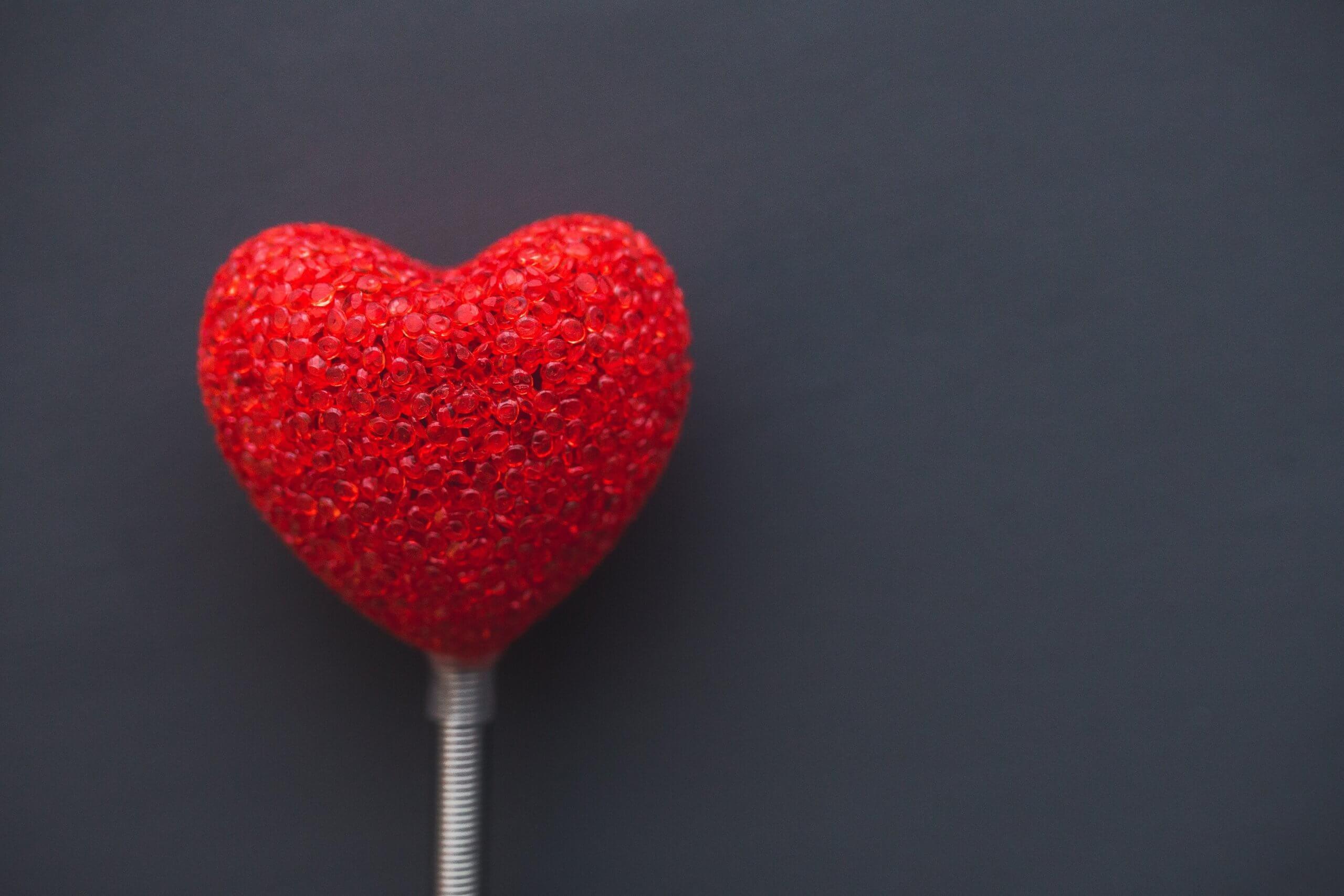 Red heart against dark grey background